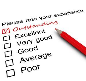 Survey form with a tick placed in Outstanding checkbox.